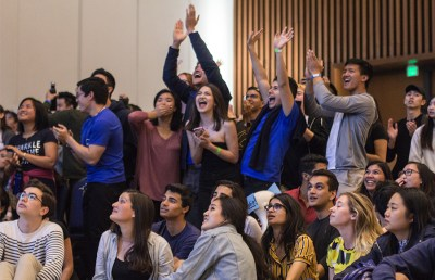 Student Action supporters cheer as their candidates are elected. Karen Chow/Staff