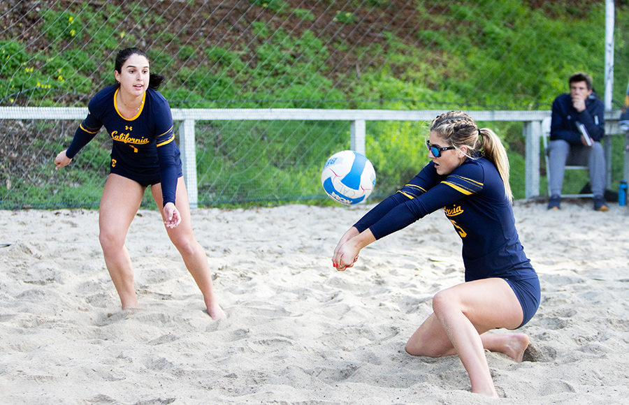 Volleyball player bumps ball.