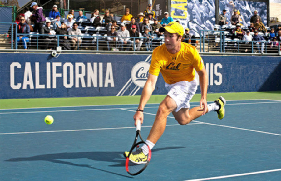 A tennis player watches the ball follow through after striking it with his racket.