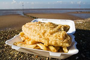 Fish and chips, a popular take-away food of th...