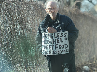 Homeless man begs along Shore Parkway.   Original Filename: DSC_6010.jpg