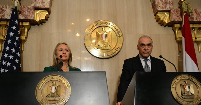 Egyptian Foreign Minister Mohamed Kamel Amr (R) and US Secretary of state Hilary Clinton give a joint press conference after their meeting with President Mohamed Morsi  announcing a truce. AFP Photo