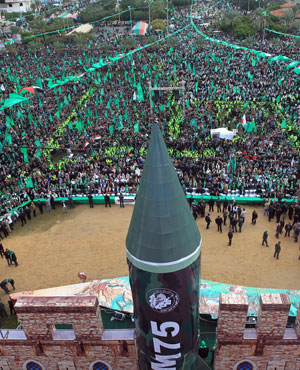 Supporters of Hamas gather during a rally to mark the 25th anniversary of the founding of the Islamist movement, in Gaza. (AFP PHOTO/ MAHMUD HAMS)