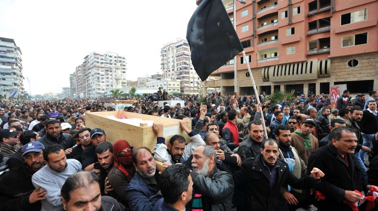 Egyptian mourners carry the coffins of six people killed in clashes the day before, during their funeral in Port Said, on January 28, 2013. (AFP File Photo / Stringer)
