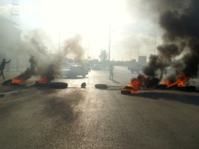 Families of prisoners in Sinai blocked off the Al-Arish central Sinai road in southern al-Arish, preventing night shift workers from arriving at cement factories in the centre of the peninsula. ( Photo by Nasser El-Azzazy)