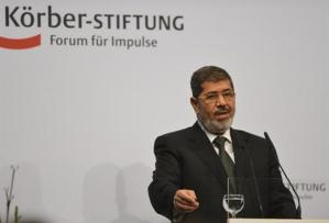 The presidency released a statement while Mohamed Morsy was in Berlin welcoming the Al-Azhar initiative (AFP Photo / Odd Andersen)