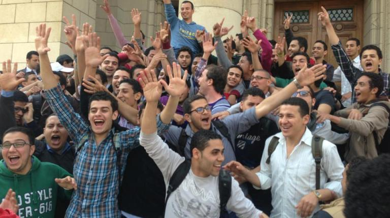 Students victoriously carry Hesham Ashraf, the newly elected head of Cairo University student union, on their shoulders.  (Photo Courtesy of Misr Alqawia students Facebook page)