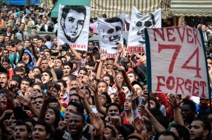 Supporters of Egypt's Al-Ahly football club protest outside the public prosecutor's office in Cairo on March 16, 2013, demanding the release of fellow members of their Ultras hardcore fan group. The Ultras have long had strained relations with police, but tensions boiled over after a deadly stadium riot in the canal city of Port Said last year in which many fan group members died.   (AFP PHOTO/MOHAMED EL-SHAHED)