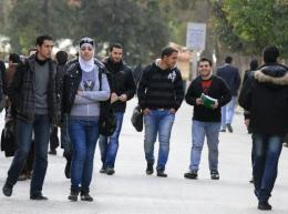 Syrian students walk on campus at a Damascus university on February 23, 2012 (AFP/File, Louai Beshara)