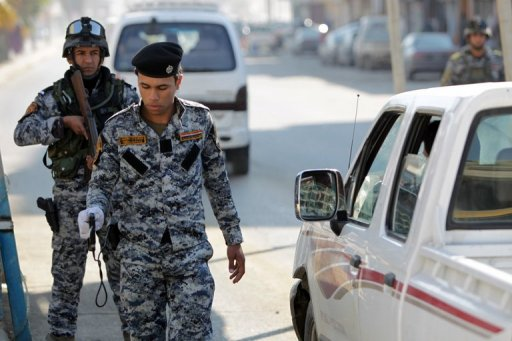 An Iraqi security officer holds a bomb detector device at a checkpoint in central Baghdad. (AFP/File/Ahmad al-Rubaye)