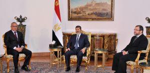 Libyan Prime Minister Ali Zeidan met with President Mohamed Morsi and Prime Minister Hesham Qandil on Thursday at the presidential palace in Cairo.