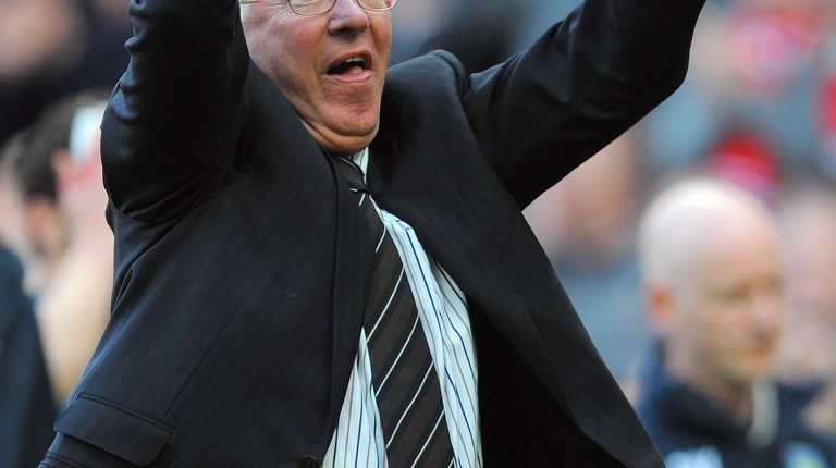 A file picture taken on April 5, 2009, shows Manchester United manager Alex Ferguson celebrating after victory over Aston Villa in Manchester. (AFP File Photo)