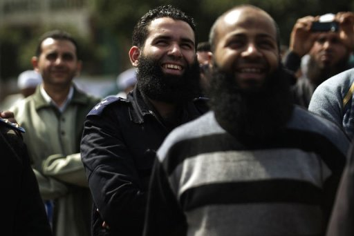 A bearded Egyptian police officer takes part in a protest by Salafists demonstrating over a lack of enforcement of a recent court order permitting bearded police officers to serve in Cairo on March 1, 2013.( AFP File Photo)