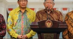 Ketua Umum MUI Kiai Ma'ruf Amin bersama Menteri Agama Lukman Hakim Saifuddin. (liputan6.com)
