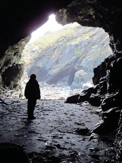 CJ Shelton in Merlin's Cave at Tintagel, Cornwall, England