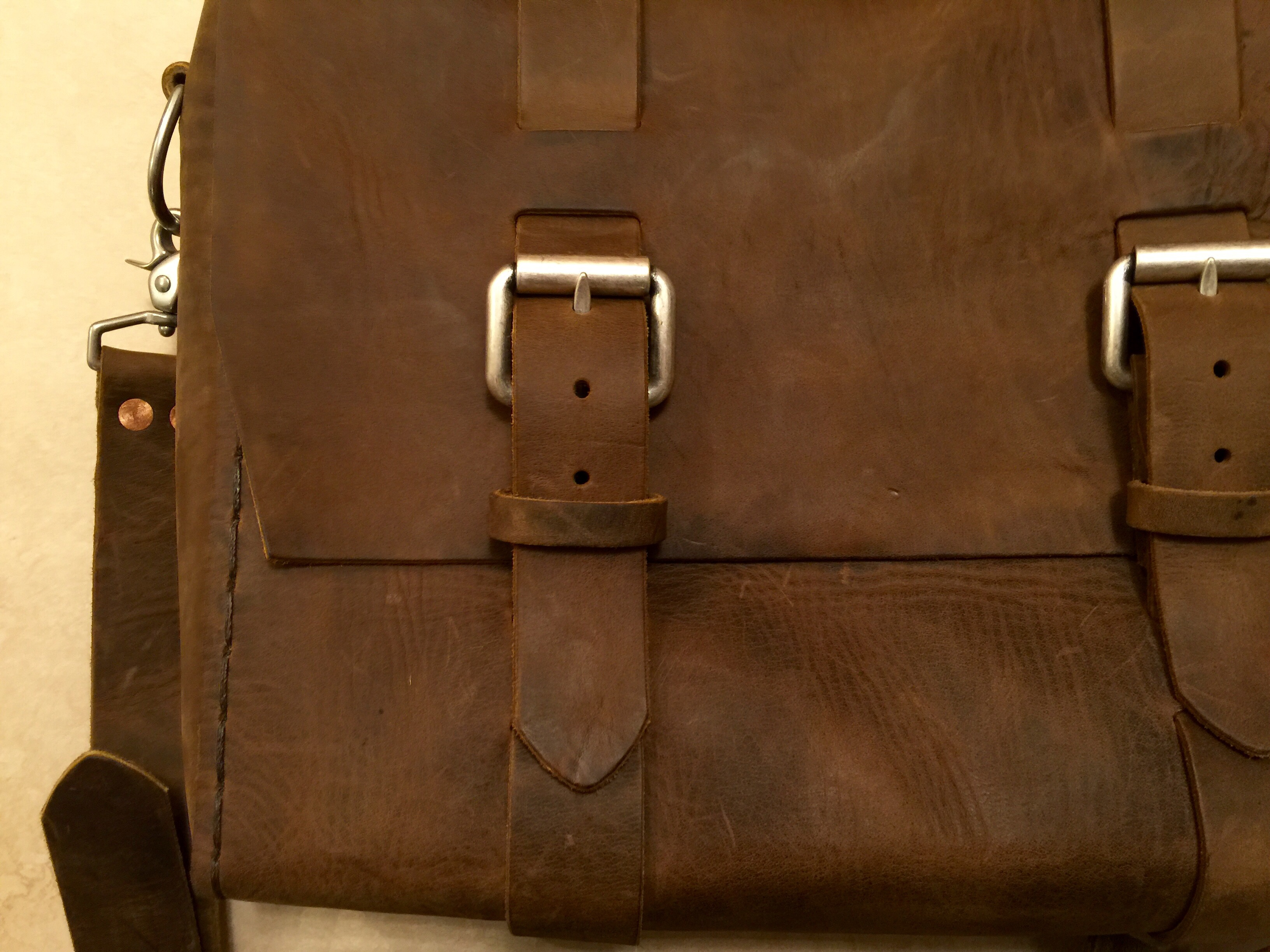 how to break in leather bag