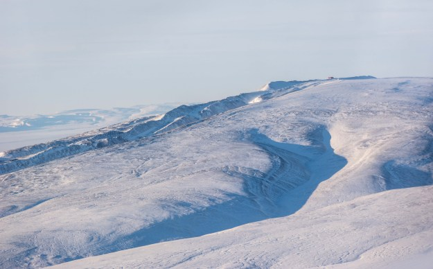The PEARL Ridge Lab perched upon a high Arctic ridge, viewed from a plane departing Eureka, Nunavut.