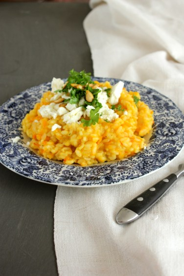 Pumpkin risotto with goat cheese, pumpkin seeds and parsley