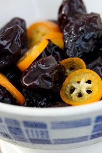 poached prunes and kumquats