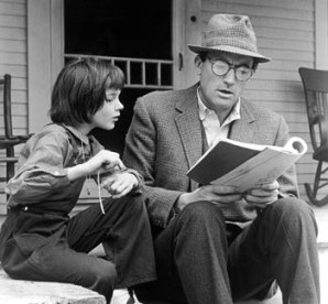 1962, American actors Gregory Peck (1916 - 2003) and Mary Badham review the script for the film, 'To Kill a Mockingbird' directed by Robert Mulligan, on the set of the film. Peck won his only Oscar for Best Actor for his role in the film, while Badham was nominated for Best Supporting Actress. (Photo by Universal Studios/Getty Images)