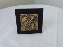 Carved grape tile by Diane Kline