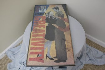 $90 VALUE - Est. 1924 MGM poster framed, donated by the Art Spot