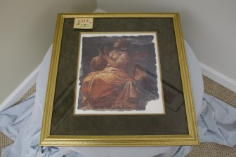 $130 Value - Framed and matted print of woman, donated by the Art Spot