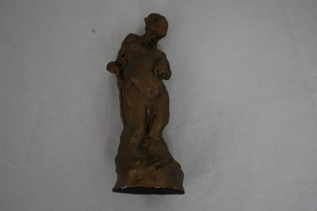 $125 VALUE - Bronze colored resin sculpture of a person by artist Craig Campbell