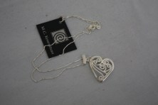$55 VALUE - Sterling silver filligree heart by artist Mary Kernahan