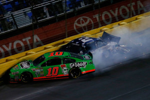 CONCORD, NC - MAY 26:  Danica Patrick, driver of the #10 GoDaddy.com Chevrolet, and Brad Keselowski, driver of the #2 Miller Lite Ford, are involved in an incident during the NASCAR Sprint Cup Series Coca-Cola 600 at Charlotte Motor Speedway on May 26, 2013 in Concord, North Carolina.  (Photo by Jeff Zelevansky/Getty Images)
