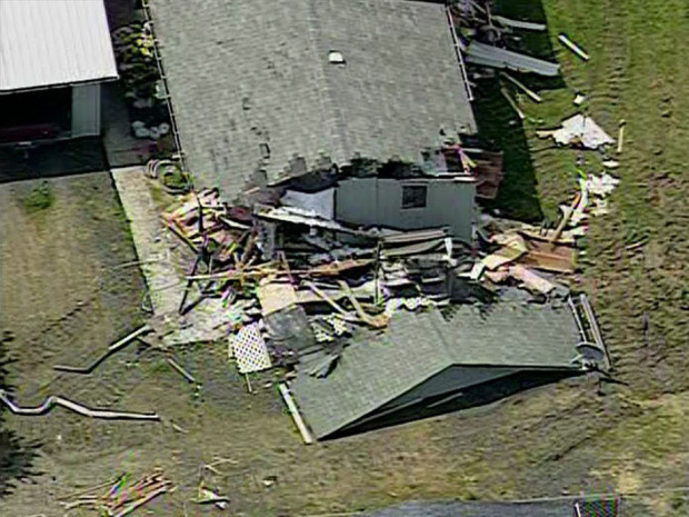 This frame grame from aerial video footage provided by KOMO-TV shows damage allegedly caused by Barry Alan Swegle, a man angry at his neighbors who went on a rampage in a bulldozer, damaging four homes, knocking one off its foundation and cutting power to thousands of people, authorities said, Friday, May 10, 2013 in Port Angeles, Wash. Swegle was booked into the Clallam County Jail for investigation of malicious mischief following the incident. (AP Photo/KOMO-TV) SEATTLE OUT, DAILY MAIL OUT, NY POST OUT