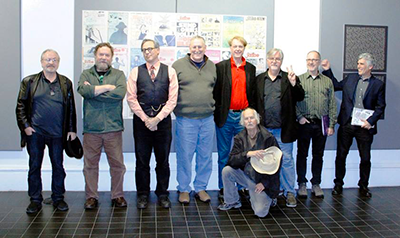 Posing in front of the wall of Scribe covers: Monte Wolverton, Patrick Rosenkranz, me, Maurice Isserman, Bill Plympton, Matt Groening, Richard Gehr, Norman Solomon, (front) Walt Curtis.