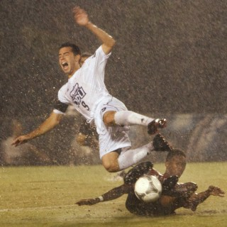There's not much better than slide tackling someone on a wet field.