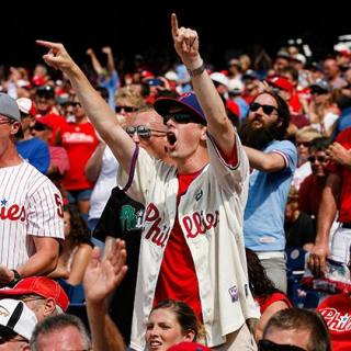 These baseball fans might be cheering for their team... or just happy about being outside on a nice day!