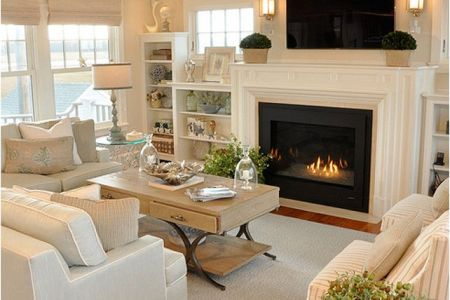 cosy white living room with fireplace
