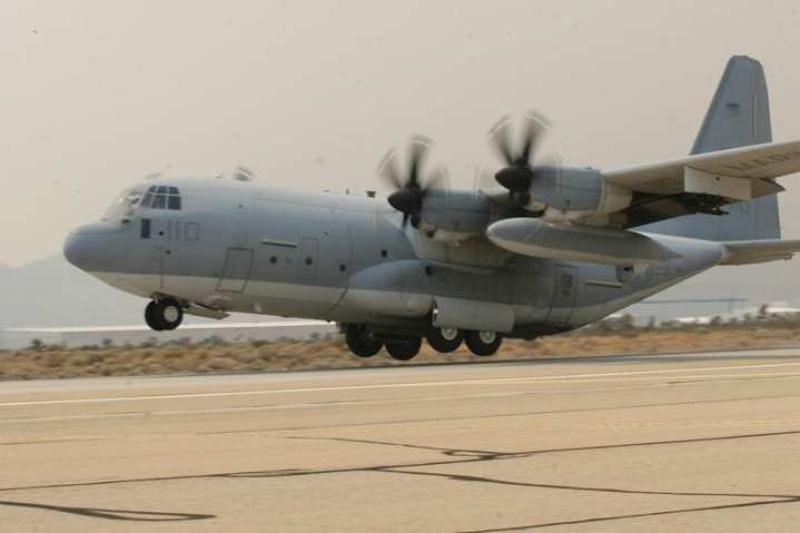 """Test pilots and aircrew from Air Test and Evaluation Squadron 20 take off in a KC-130J """"Super Hercules,"""" belonging to Marine Aerial Refueler Transport Squadron 352 during its first flight with the new Harvest Hawk mission kit at Air Force Plant 42. Note the TSS mounted to the port under wing fuel tank and the four Hellfire launch rails on the outboard wing pylon. Official U.S. Marine Corps photo by Cpl. Christopher O'Quin"""