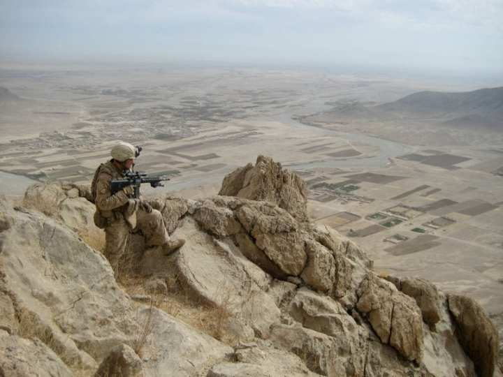 U.S. Marine Corps Lance Cpl. David Gressley, with Lima Company, 3rd Battalion, 4th Marine Regiment, follows a ridge line on a mountain in Now Zad Valley, Afghanistan, Nov. 7, 2009. U.S. Marine Corps photo by Cpl. Daniel M. Moman.