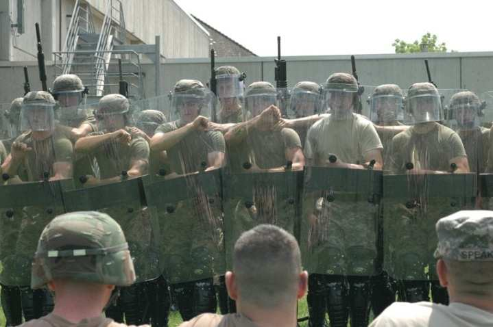 Marines assigned to 2nd Platoon, Marine Corps Security Force Company, Rota, Spain; and soldiers from 1st Armored Division and the Joint Multinational Readiness Center based in Germany, conduct crowd control training June 14, 2006. Approximately 70 soldiers and Marines participated in a week-long, non-lethal weapons training evolution culminating in a capabilities exercise June 21.  The capabilities exercise demonstrated the various non-lethal equipment and techniques available in the European Command Theater of operations. U.S. Marine Corps Forces Europe is the designated non-lethal weapons executive agent for the European Command. DoD photo by Gunnery Sgt. Donald E. Preston.