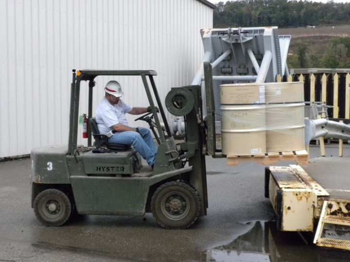 The U.S. Army Corps of Engineers' Robert Murphy, a stock record account officer, loads a pallet of hydraulic oil for shipment to one of the locks managed and maintained by the Corps' Pittsburgh District Office. The U.S. Army Corps of Engineers Logistics Activity coordinates the shipping and delivery of hydraulic oil and the many other supplies needed to keep USACE running. Photo courtesy of the U.S. Army Corps of Engineers