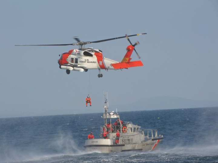 Coast Guard rescue crews worked together, Nov. 8, 2009, to help an injured crewmember aboard a sailboat near Matinicus Island, Maine. A 47-foot boatcrew from Coast Guard Station Rockland launched to the scene and escorted the Shiela, a 27-foot sailboat, to meet an MH-60 Jayhawk helicopter crew from Coast Guard Air Station Cape Cod, who would airlift the patient. Coast Guard photo/Station Rockland