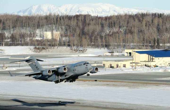 A C-17 Globemaster III takes off from Elmendorf Air Force Base, Alaska, March 26, 2010. Col. Thomas Bergeson, 3rd Wing commander and F-22 Raptor pilot, was behind the controls of the aircraft for the first time. The flight included a KC-135 Stratotanker refuel, tactical arrivals and departures at Allen Army Airfield, and low-level flying. The Globemaster III fleet has been particularly stressed by heavy use during the last decade. U.S. Air Force photo by Staff Sgt. Brian Ferguson