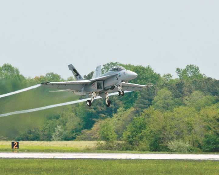 """The Navy celebrated Earth Day by showcasing a supersonic flight test of the """"Green Hornet,"""" an F/A-18 Super Hornet strike fighter powered by a 50/50 biofuel blend. The test, conducted at Naval Air Station Patuxent River, Md., drew hundreds of onlookers that included Secretary of the Navy Ray Mabus, who has made research, development, and increased use of alternative fuels a priority for the Department of the Navy. U.S. Navy photo by Kelly Schindler"""