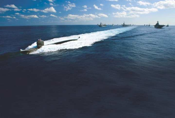 "The Los Angeles-class attack submarine USS Houston (SSN 713) leads a formation of ships from USS George Washington (CVN 73) Carrier Strike Group and Japan Maritime Self-Defense Force (JMSDF) for a photo exercise during the final day of Exercise Keen Sword 2011. The U.S. Navy seems headed for a ""Two-Hub"" scenario, concentrating on the Western Pacific and the Middle East and Indian Ocean. U.S. Navy photo by Mass Communication Specialist 3rd Class Adam K. Thomas"