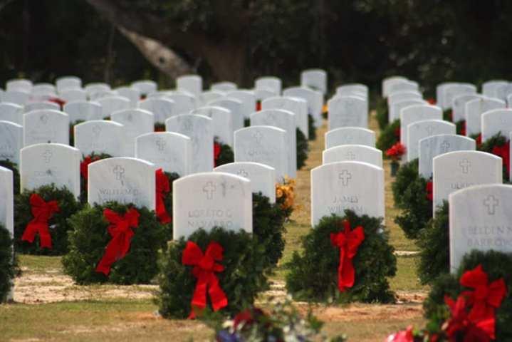 Wreaths placed at the tombstones of deceased veterans at Barrancas National Cemetery in Pensacola, Fla. U.S. Navy photo by Steve Vanderwerff