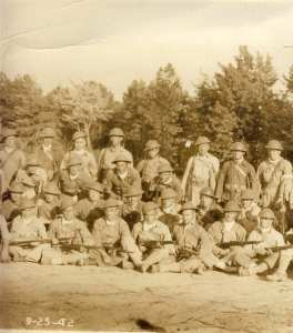 Author Dwight Jon Zimmerman's father with his company and World War I equipment