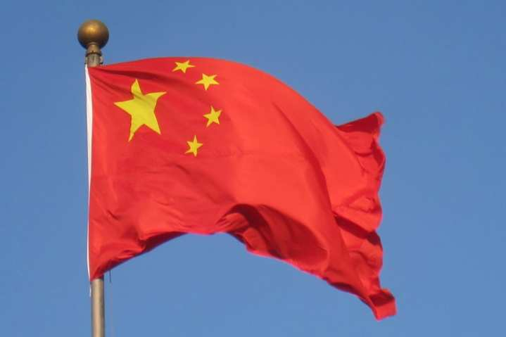 A Chinese flag flies over Beijing