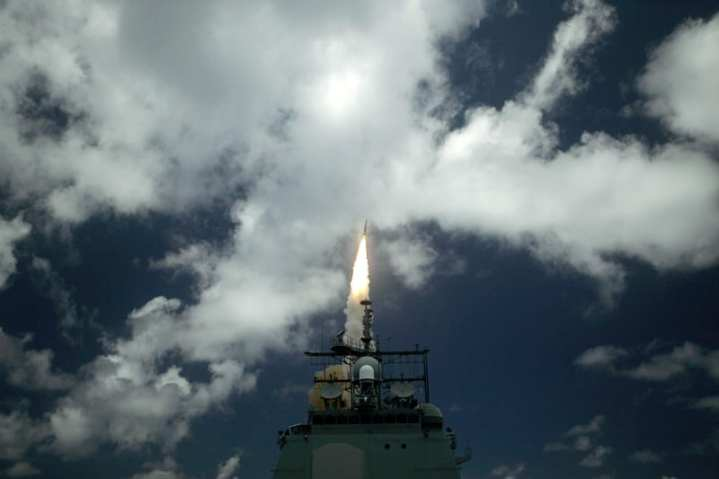 A Standard Missile Three (SM-3) is launched from the guided missile cruiser USS Shiloh (CG 67) during a joint Missile Defense Agency, U.S. Navy ballistic missile flight test, June 22, 2006. Two minutes later, the SM-3 intercepted a separating ballistic missile threat target, launched from the Pacific Missile Range Facility, Barking Sands, Kauai, Hawaii. The test was the seventh intercept, in eight program flight tests, by the Aegis Ballistic Missile Defense. The maritime capability is designed to intercept short to medium-range ballistic missile threats in the midcourse phase of flight. U.S. Navy photo