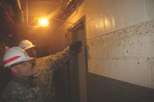 Soldiers with the 249th Engineer (Prime Power) Battalion visit the Red Hook housing complex in Brooklyn that lost power during Hurricane Sandy, Nov. 7, 2012. The Soldiers were working through FEMA and with city and state officials to conduct assessments to determine if and how electrical power could safely be installed. Note the high water mark they are inspecting. U.S. Army photo by Brooks Hubbard