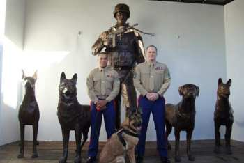 Lucca was the first MWD to view the Military Working Dog monument. Gunnery Sgt. Chris Willingham (right) and Cpl. Juan Rodriguez (left) were Lucca's handlers. Facebook: Lucca K458
