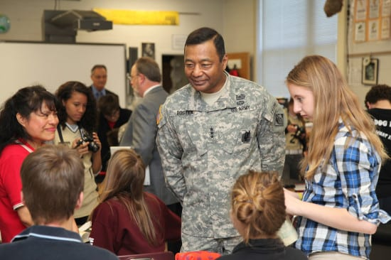 Louisville District structural engineer Mercedes Hughes (left) and U.S. Army Corps of Engineers Commander Lt. Gen. Thomas P. Bostick visit students April 10, 2014, at Scott Middle School to view the progress of the USACE STEM education program. Photo by Debra Hunter
